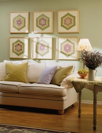 Decorating with quilts: Mount pieced quilt blocks onto contrasting mat boards, then add non-glare glass with matching frames and you've got a great wall grouping