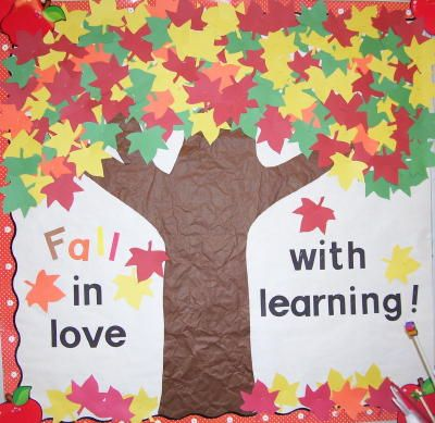 """This teacher has mixed red, yellow, orange, and green leaves together to create a very colorful fall bulletin board display idea for the theme:  """"Fall In Love With Learning!"""""""