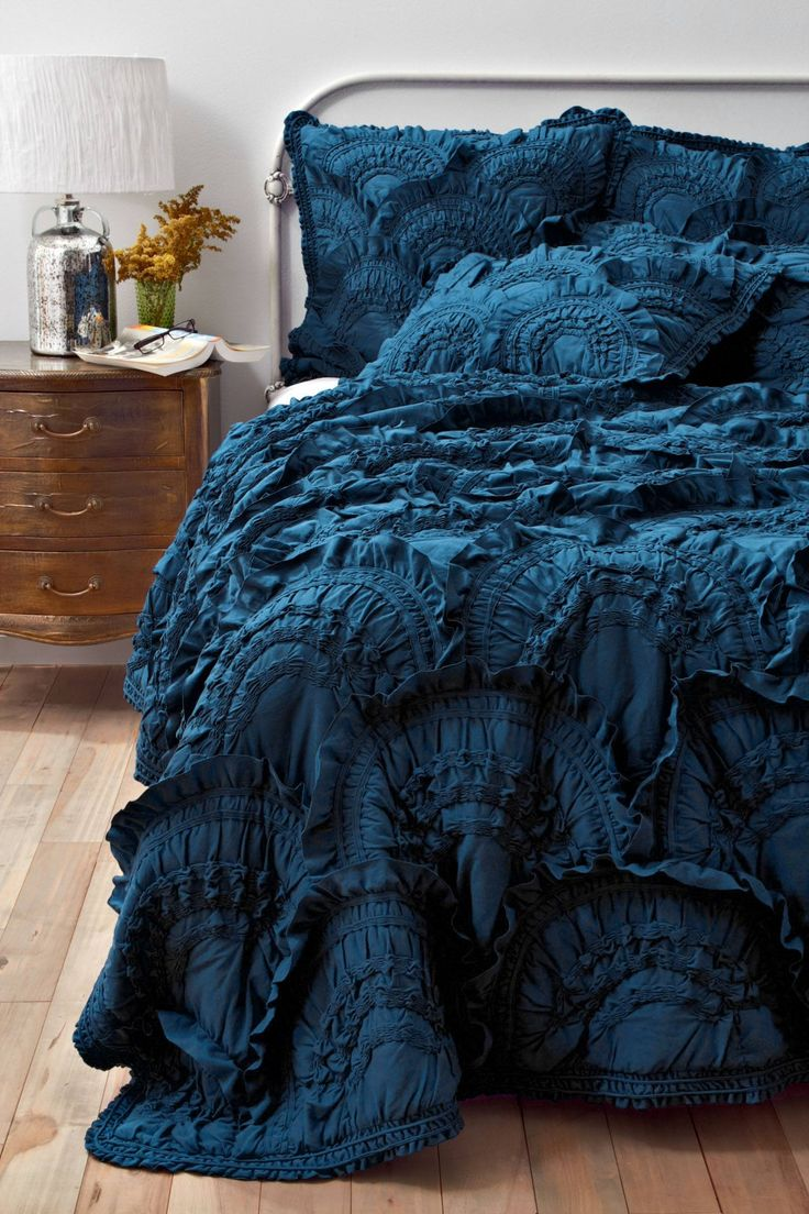 The ruffled texture lends to the romantic trend seen this fall , while this trend is popular in romantic neutrals, this jewel tone helps to combine two fall trends together cohesively