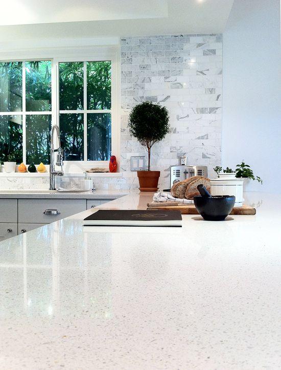 Countertop : Quartz Cimstone Lapland 3cm, Backsplash : Statuary white marble 2″x4″ tile at The New Domestic  love love love the countertop