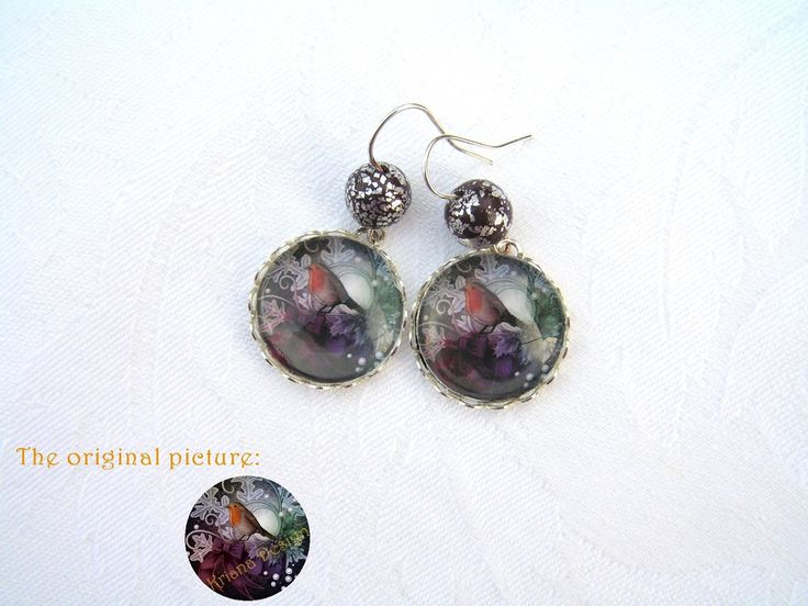 Robin earrings  --    Beautiful 20 mm glass lens earrings completed with small, (silver) metal leaves decorated polymer clay beads.  Length of the earrings: 35 mm