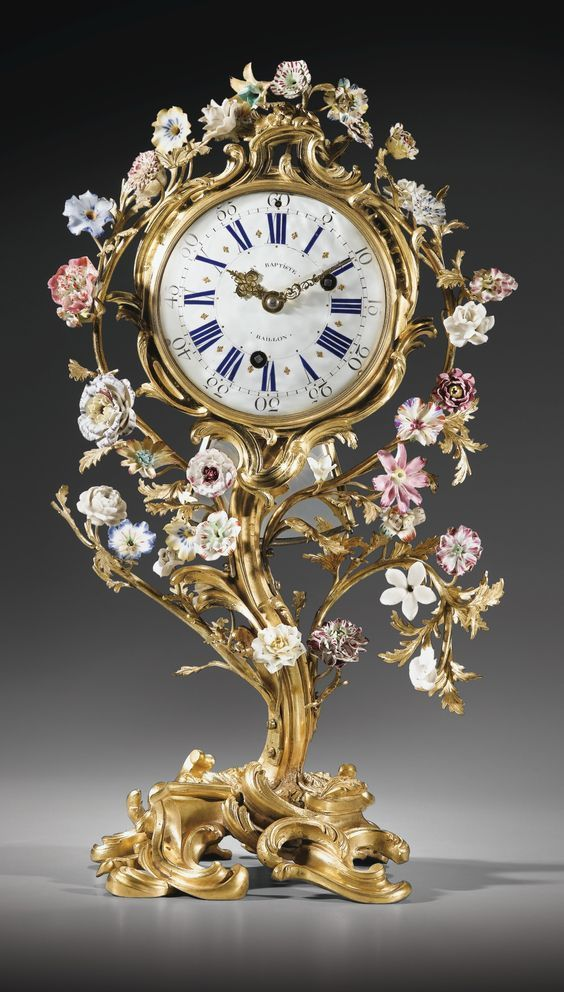Clocks, The Beautiful Time Keeper..|Louis XV Gilt-porcelain mantel clock, signed JN Baptiste, 1753.|Source:Sothebys.com|beautyandtheharpsicord/Tumblr.com|-- The tiny light pink and white flowers surrounding this clock face make what could have been a simple looking time piece, into a very eye catching one.