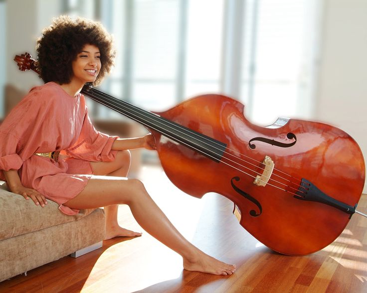 "Esperanza Spalding with her Doolin Acoustic Bass Guitar. Esperanza's new album ""Radio Music Society"" is in stores Tuesday, 3/20."