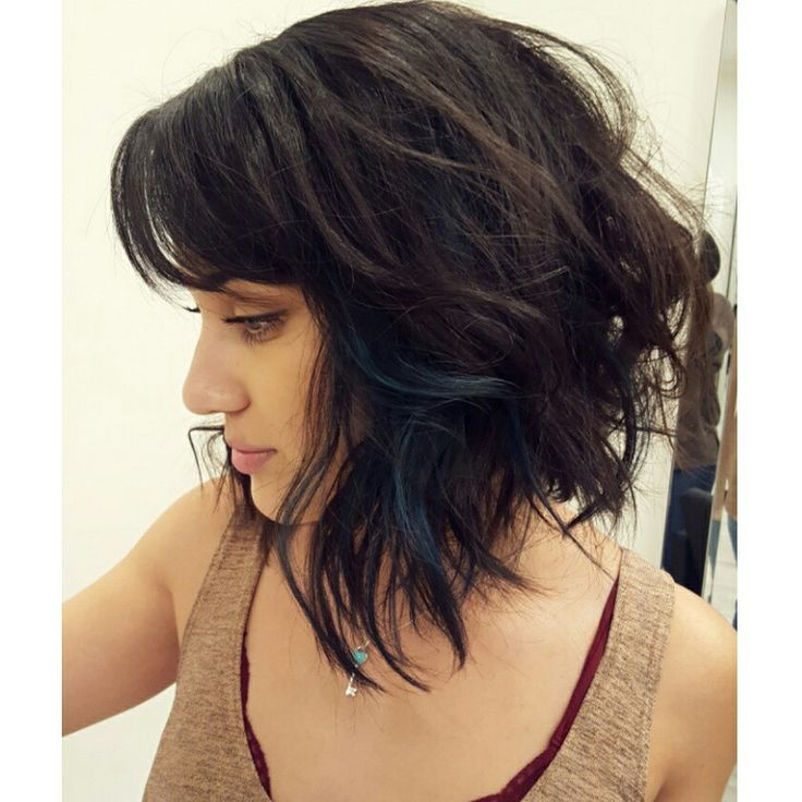 Textured lob haircut , dark color and peekaboo of Teal by