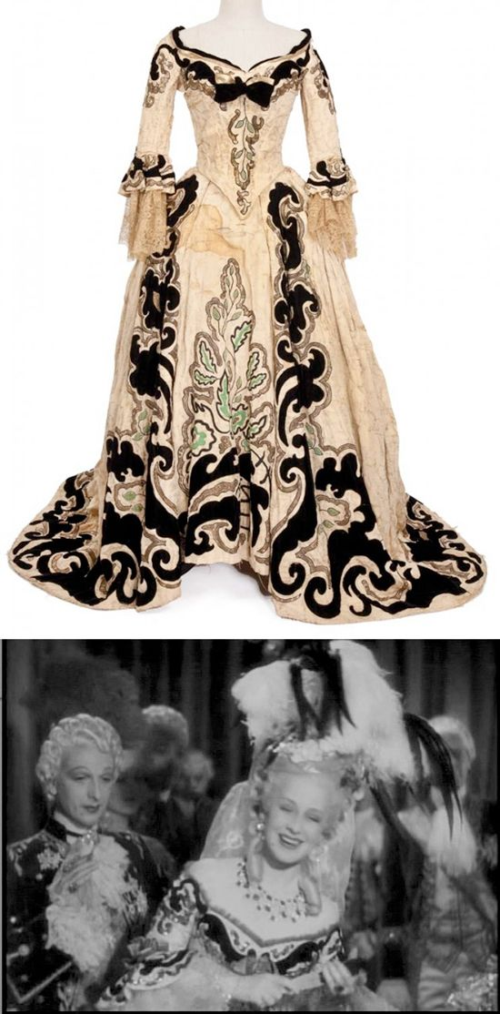 "Norma Shearer ""Marie Antoinette"" ivory with black velvet two-piece period gown by Adrian from Marie Antoinette. (MGM, 1938) Ivory two-piece period gown, black velvet design, sequins, gold thread and delicate lace at cuffs.  Worn by Norma Shearer as ""Marie Antoinette"" at the opera in Marie Antoinette. [photo compilation LB]"