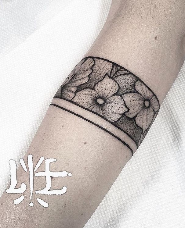 Floral armband tattoo. - Lawrence Edwards                                                                                                                                                                                 More