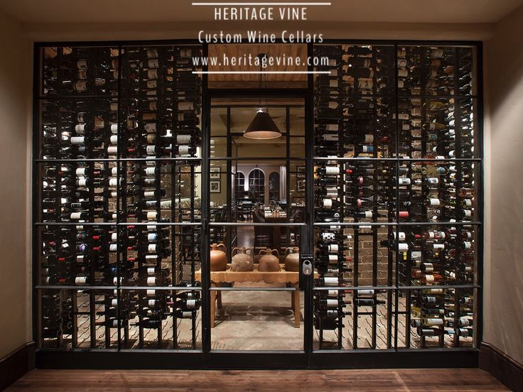 Commercial wine display Commercial wine cellar -a stunning wine wall at the D.C. Ranch Country Club in Scottsdale. Designed and installed by Heritage Vine Custom Wine Cellars
