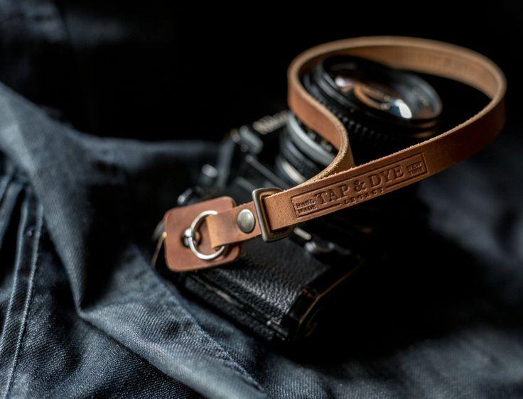Handmade Leather Camera Wrist Strap for Digital and Film Cameras - Olympus OMD, Fuji X100, Sony NEX, Leica M: Dark Amber Beeswax. $52.00, via Etsy.
