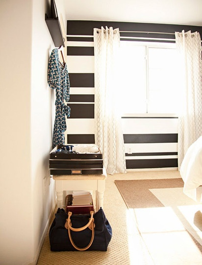 White, warm rooms with bold black stripes on an accent wall?