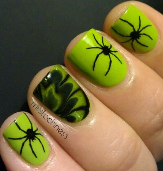 Creepy Radioactive Spider Halloween Nails Art. Black and green spider and watermarble Halloween nail design.
