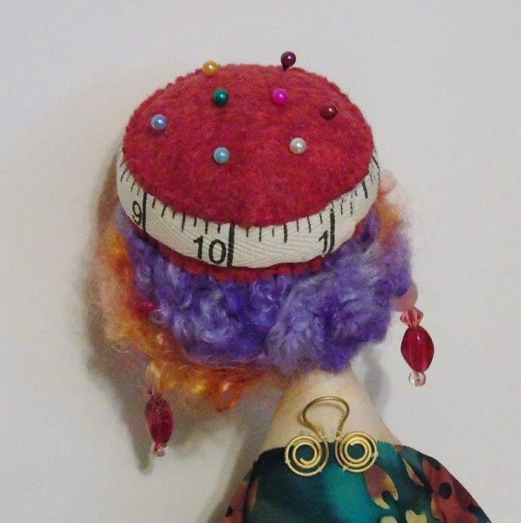 Sewing Granny's pincushion hat.