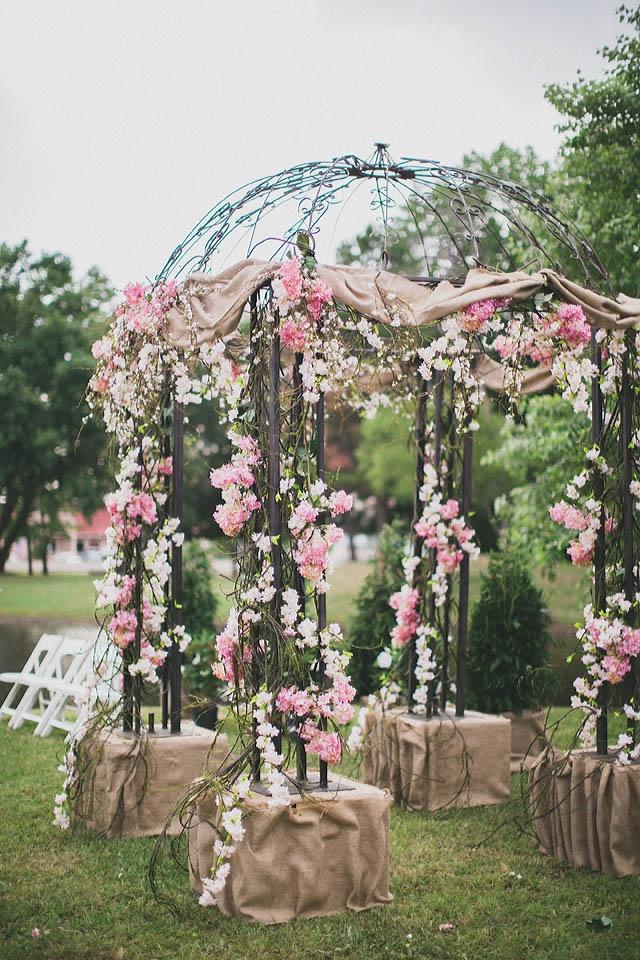 Pink Flower And Burlap Gazebo Ceremony Decoration Image