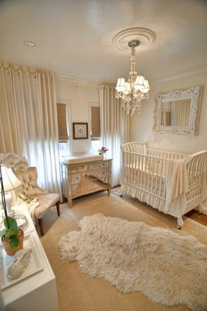 Gender neutral nursery (I would probably use for a little girl). What I love about this room is how elegant everything is...the ornate mirror above the crib, the little dresser that looks like it's vintage and the chandelier. I would probably incorporate just a little bit of color somewhere, but the whole thing is just stunning.