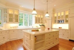 Traditional Kitchen with Kitchen island, Glass panel, Crown molding, Pendant light, Subway Tile, Undermount sink, U-shaped