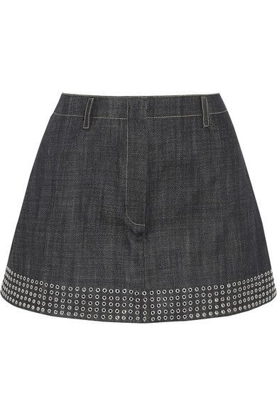 Alaïa's mini skirt is cut from dark-blue Japanese denim, specially selected by Azzedine himself for its quality and texture. Fitted with built-in shorts for a fresh, sporty feel, this A-line piece is decorated with scores of silver eyelets along the hem – a brand signature first used by the designer on a pair of gloves in 1979. Emphasize the flattering high waist with this white bodysuit.