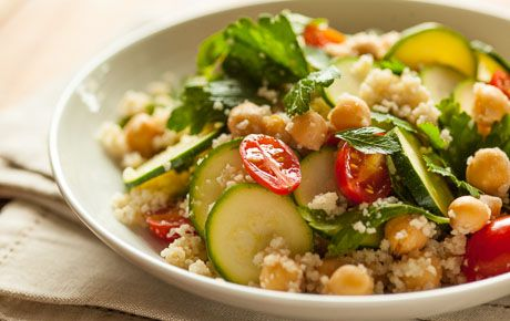 Creamy tahini and tart wine vinegar dress whole wheat couscous, tossed with tomatoes, zucchini and garbanzo beans. Follow the time-saving techniques in the method to make extra-quick work of this salad or light main course.