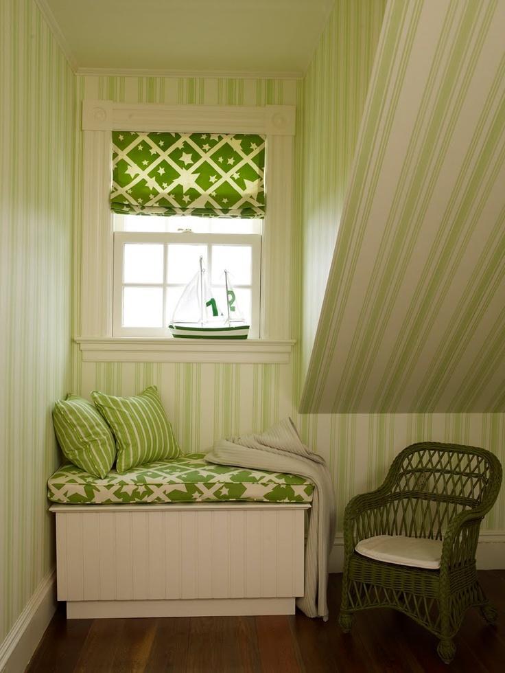 Green striped wallpaper in an attic kids room.  Very cute.