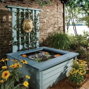 Outdoor Pond Ideas: Pond in a Box - The beauty of a pond without the shovel work. And great if you hate frogs like me because they can't get in or out of high sided ponds like this...