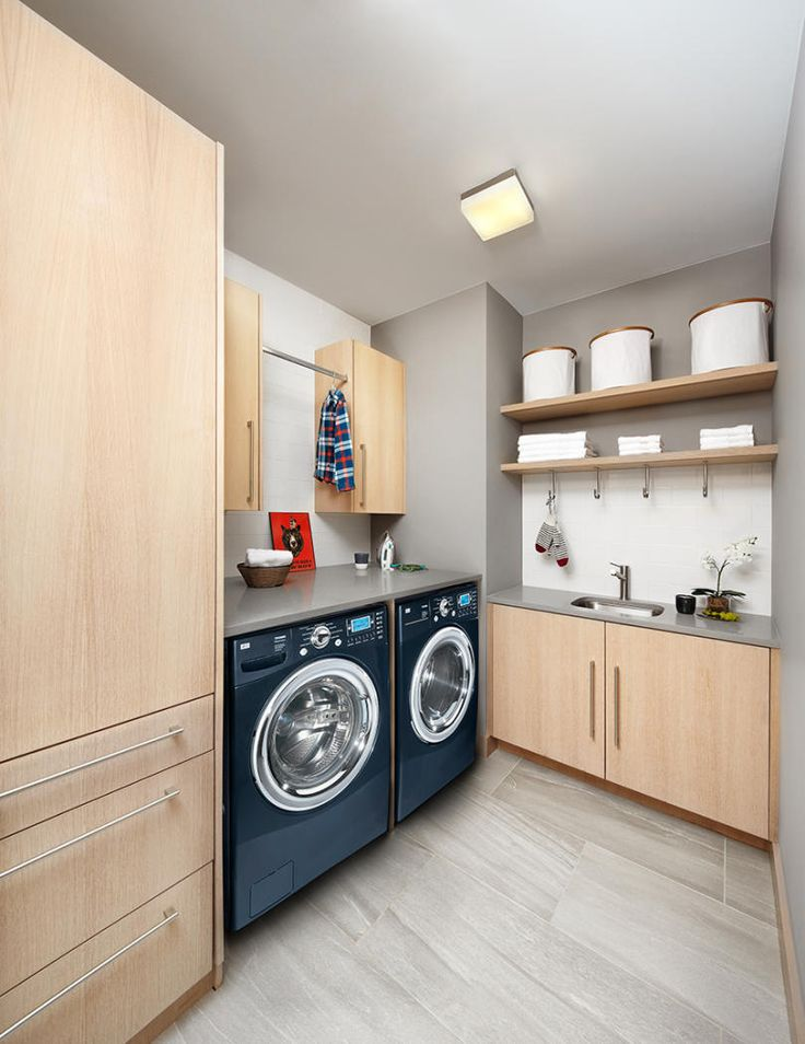 This laundry room from a home in California has plenty of storage and countertops built in.