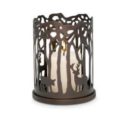 Enjoy a scene from the winter woods indoors. A rustic pierced metal surround of trees and deer creates an enchanting effect when lit by a GloLite or round pillar. Also can be used with a 3-wick jar. All candles are sold separately. 6 3/4