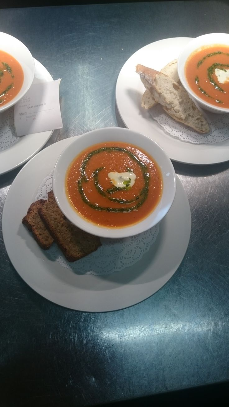 Carrot and corriander soup creme fresh and basil pesto
