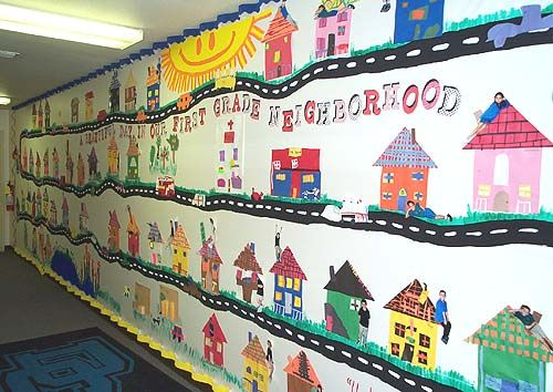 First Grade Neighborhood First graders made houses with a construction paper collage.