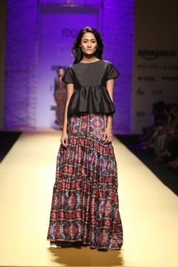 This modern and contemporary collection by Reynu Tandon for her brand Mynah at Amazon India Fashion Week Autumn/Winter 2016 used colourful geometric prints as the anchoring theme. Long skirts and flared trousers gave the show a hippy but chic tone.  #Amazon#AIFW#2016#Autumn#Winter#Fashion#Models#IndianDesigner#StrandofSilk#colourful#print#ReynuTandon#indian fashion designer#fashion show#catwalk