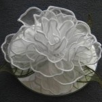 """PINNER WRITES Some of the designs were used for the wedding of Lea's daughter. Like the """"3D rose"""", we made 30 of these roses, we put leaves undernead en taped it on a CD. That makes it easier to put them on the tables."""