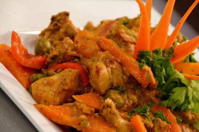 CHICKEN STEW WITH PEANUT SAUCE =  1 whole chicken 2½T vegetable oil 1T Spanish paprika 1T achuete powder 2T fish sauce (patis) 2 cups chicken stock ¼ cup ground toasted rice ¼ cup ground peanuts 1/3 cup pitted green olives 1 head garliC 1 onion 1 red bell pepper, cut into 1-inch pieces 1 carrot, cut into 1½ pieces 1 stalk celery olive oil for drizzling     salt and pepper ====