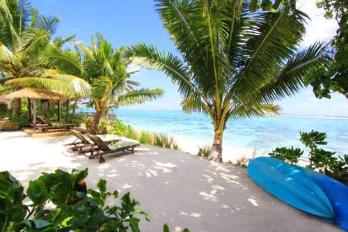 Moana Sands Beachfront Villas Rarotonga Situated in the Vaimaanga district in Rarotonga, Moana Sands Beachfront Villas offers a garden and barbecue. Muri is 8 km away. Free private parking is available on site. All units include a seating area with a flat-screen TV and DVD player.