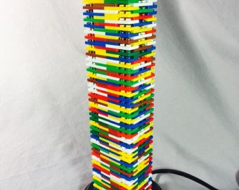 This is a handmade, Black & Multicolor Lego Lamp. Wooden bottom/stand has a layer of felt underneath to ensure no scratches upon tabletops. Lamp shade is included at an additional cost.     ~~~~~~~~~~~~~~~~~~~~~Save on Shipping!~~~~~~~~~~~~~~~~~~~~~ Buy any additional lamp at a discounted shipping rate!     ~~~~~~~~~~~~~~~~~~~~~~~~Lego Lamps~~~~~~~~~~~~~~~~~~~~~~~~ Custom Lego Lamps may be built upon request and product availability (whether either brand makes requested theme) so sen...