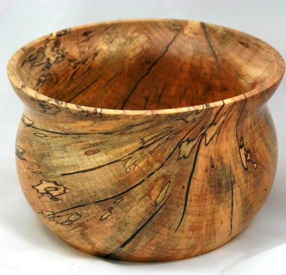 This is an interesting bowl. Made from a log that fell during a storm in North Carolina. This bowl is very spalted and had numerous cracks and