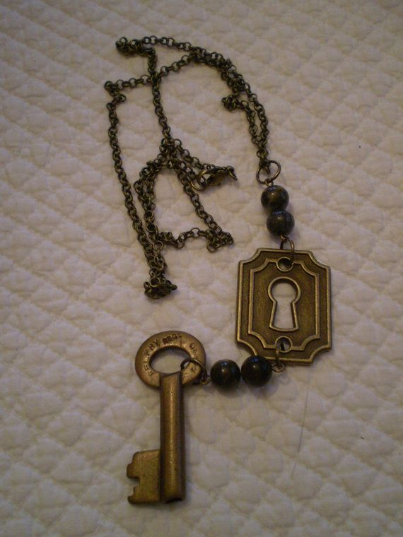 Check out this item in my Etsy shop https://www.etsy.com/listing/212046773/vintage-brass-key-and-jade-necklace-lock