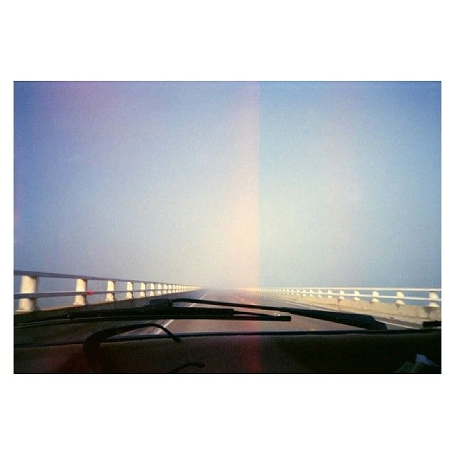 diversal:  who knows how long, or how far away we are ~ 2004 #35mm #freeway #lightleaks #haze #pulpmatter