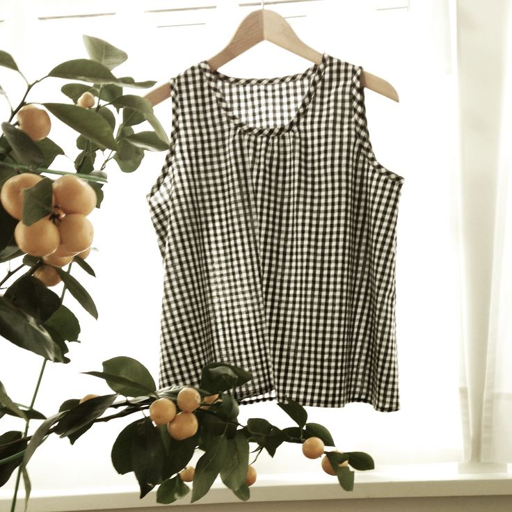 My year of making. Kiomi top in black and white cotton gingham from Lotta Jansdotter's delightful book, Lotta Jansdotter Everyday Style. So many cute patterns to try and beautiful fabrics to wish for. Wynne's orange tree in the forground.