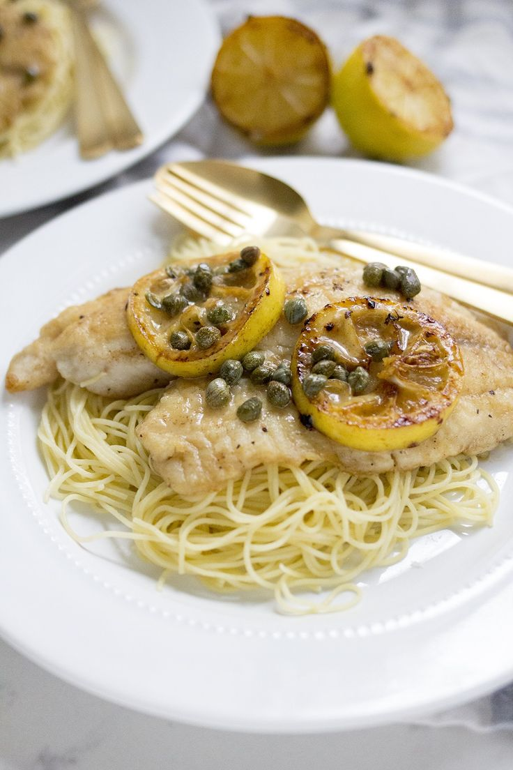 Delicious weeknight Tilapia Piccata with a lemon, white wine  and caper sauce served over angel hair pasta.
