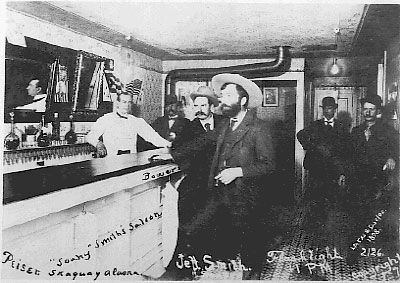 """Jeff Smith in his Parlor in Skagway. Jefferson Randolph (""""Soapy"""") Smith II (1860–1898) was a con man who operated in Colorado and Alaska from 1879 to 1898."""