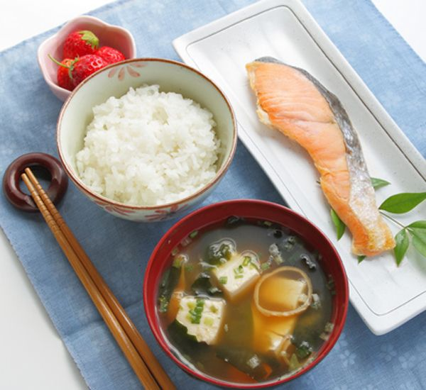 "RECIPE:- Healthy Japanese Breakfast: Rice, Miso Soup, Salmon and Beans. ""The smorgasbord of rice, soup, protein, vegetables and preserves that make up Japanese breakfasts means both that the eater will be satisfied until lunch and that the eater will be gaining a lot of important nutrients""."