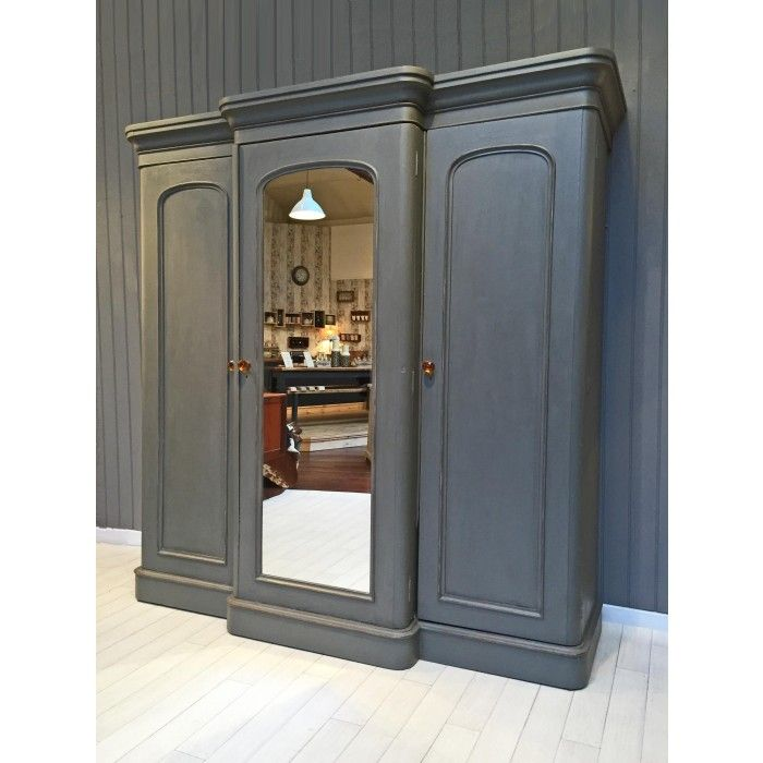 This large triple mahogany wardrobe dates back to the late 1800s and offers a huge amount of storage space. The wardrobe has been painted and waxed in a medium grey and lightly distressed for a shabby chic look,
