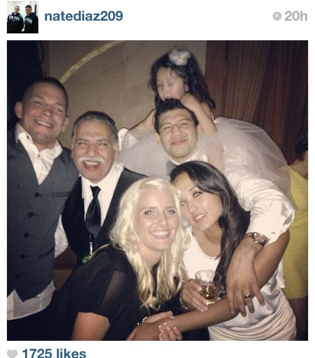 Newlyweds Gilbert Melendez & Keri Anne Taylor at the wedding reception along with their daughter, Gil's dad, Nate Diaz & his girlfriend.