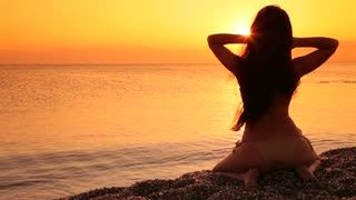 woman looking at sunset on the beach Stock Video Footage - VideoBlocks