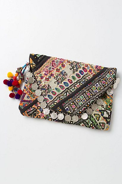 This boho clutch with coin detail is to die for!