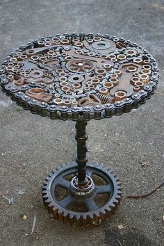 Metal art coffee table made from old car parts and gears, tools, chain, and sprockets.  #metalart Dun4Me is the marketplace for custom made items built to your exact specifications by talented makers. Get bids for free, no obligation!