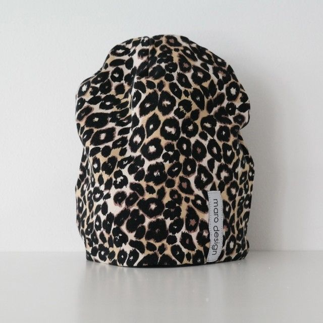 Hat in a leopard print by Maro Design #nordicdesigncollective #nordic #nordicdesign #autumn #backtoschool #backtowork #schoolstart #hat #leopard #print #hats #marodesign #brown #black #pattern #kids #adult #headwear