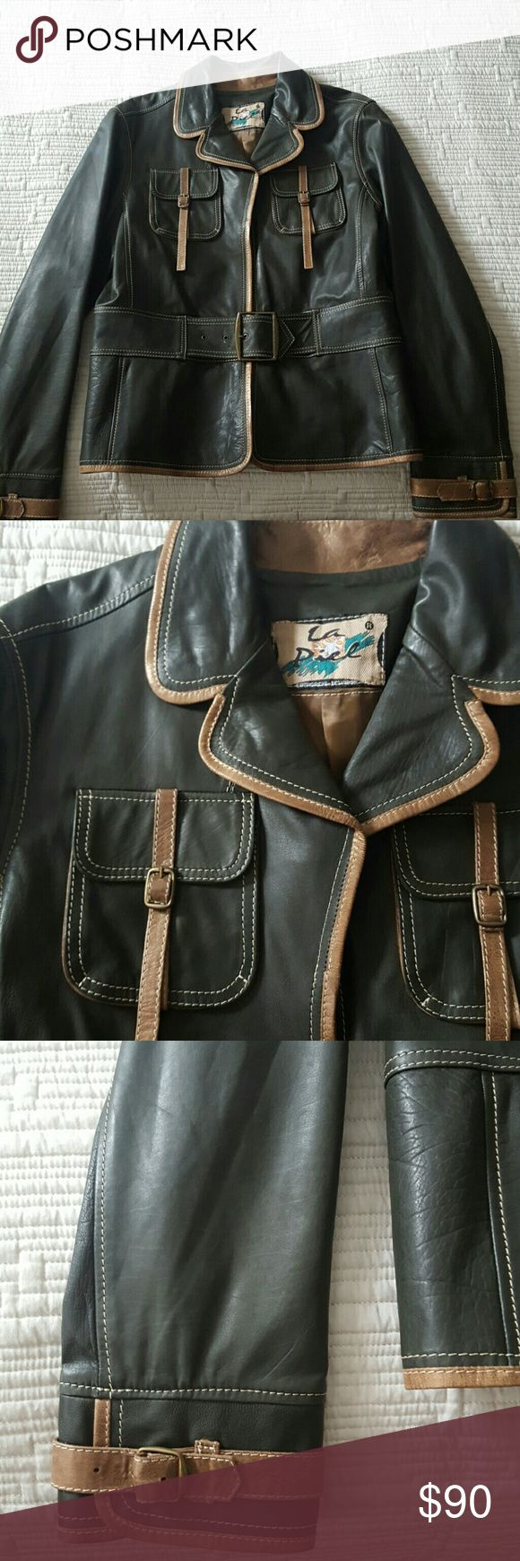 Custom Leather Jacket made in Ecuador Custom olive and bronze leather jacket made in Cotacachi, a charming Ecuadorian town known for fine leather crafting. Supple leather, fully lined. Jacket falls at hips, lower back. Only worn a few times. Very well taken care of. Minimal signs of wear. La Piel Jackets & Coats