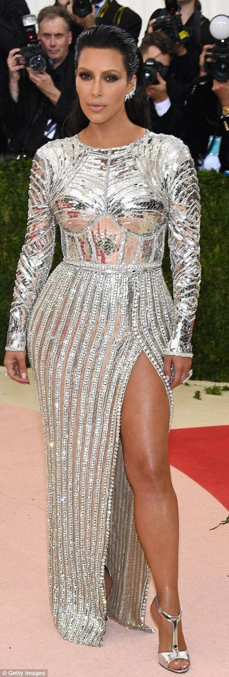 Silver stunner: Kim Kardashian appeared to be literally encased in body armour with her fu...