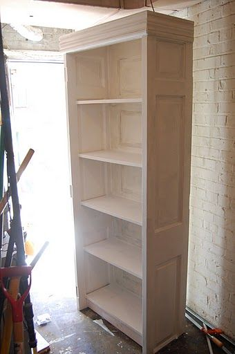 Old Door Bookcase..love the inset panels shown on sides and back of bookcase…