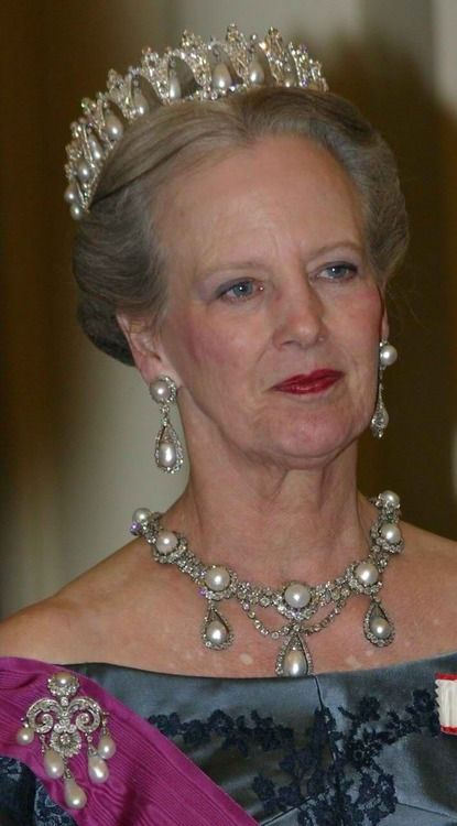 Queen Margrethe of Denmark wearing part of her collection of magnificent jewels