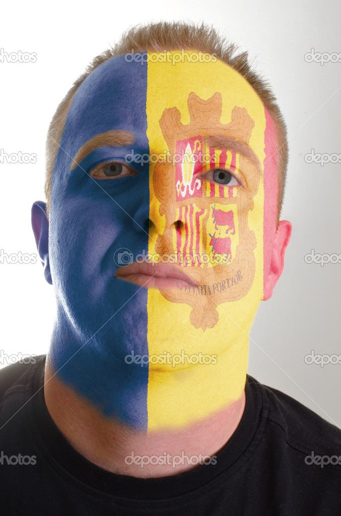 Face of serious patriot man painted in colors of andorra flag — Stock Image #8799300