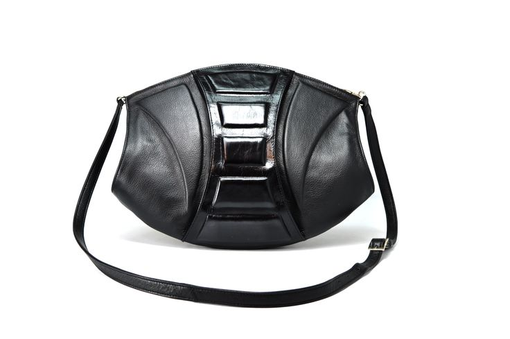 Aphrodite Mini Bag belongs to the family of luxurious geometrical handbags that will leave true accessory lovers breathless with their design and high quality. This multidimensional and rather unusual handbag can turn into a chic evening clutch with its strap off, while the cleverly designed interior allows for combinations with a long shoulder strap, making it suitable for everyday use.  TAGS: luxury, clutch, hobo, designer, leather, handmade, bag, design, tote, unique, fashion